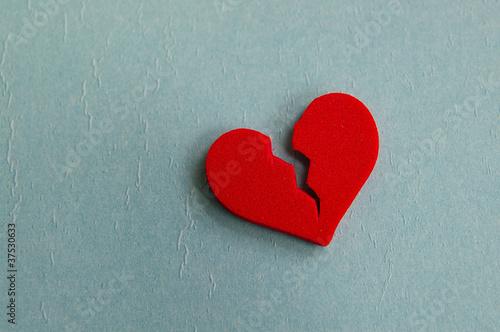 red broken heart, closeup on blue
