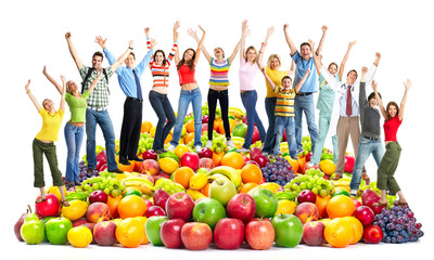 Group of happy people with fruits.