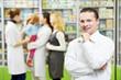 Confident pharmacy chemist man in drugstore