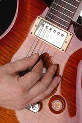 Guitar and hand close-up