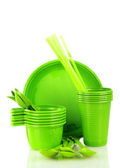 Bright green plastic tableware isolated on white