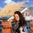 canvas print picture - Junge Handwerkerin auf dem Bau
