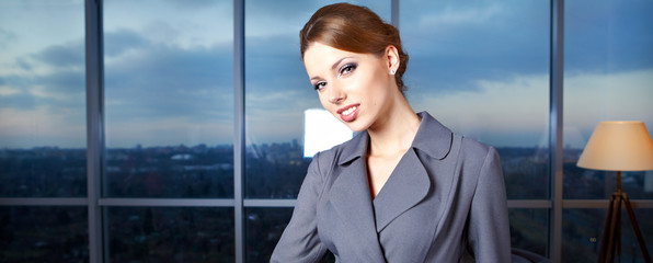 Young sexy  business woman in modern office.