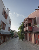 Traditional turkish row houses and stores in narrow alley