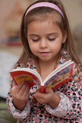 Girl looking at book