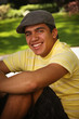 Teen Smiling with Hat
