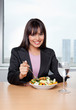 Businesswoman Eating Salad at Workplace