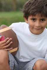 boy playing American football