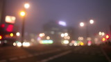 Defocused city intersection at night poster