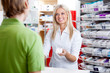 Pharmacist Giving Medicine to Customer