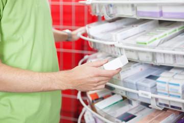 Man Holding Medication Box