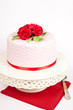 Spotted cake with red roses