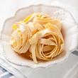 Raw italian pasta in a bowl   (pasta all'uovo- 'egg pasta')