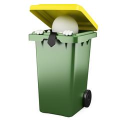 Businessman hiding in a trash bin