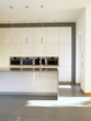 Modern minimalist buil-in kitchen in white