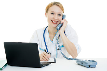 A woman doctor consultant with a laptop on a white background.