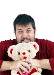 Man strangling teddy bear