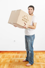New Home -Man holding box