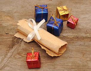 colorful gift boxes with an old scroll