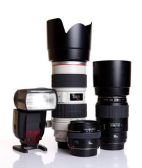 camera lenses with flash gun on white background