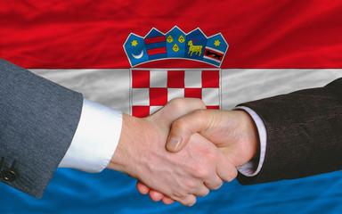 businessmen handshakeafter good deal in front of croatia flag
