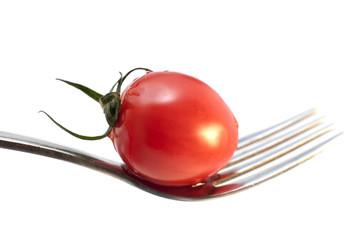 tomate isolée sur une fourchette