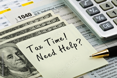 Tax forms with pen, calculator and money. - 37578612
