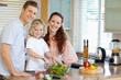 Family preparing salad