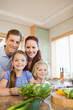 Young family standing behind the kitchen counter