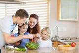 Fototapety Family preparing salad together