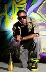 rapper sitting near wall