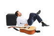Man lying with guitar in front