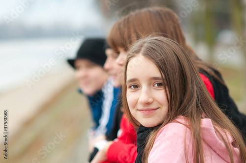 Pretty smiling girl outdoor with friends