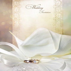 Wedding invitation card with calla lilies and golden rings