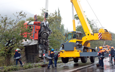 Crane lifting crashed truck