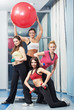 group of women with dumbbell and fitness ball