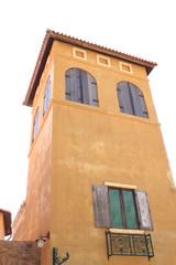 Old orange painted building.