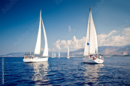 Sailing ship yachts with white sails