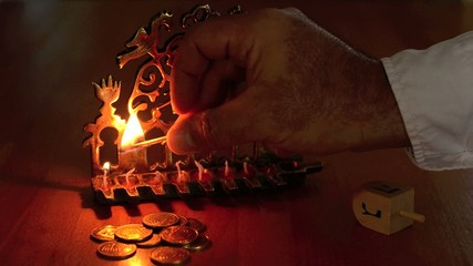 Chanukah - Hand lighting a Menorah