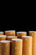 Cigarette Filters on Black Background