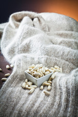 haricot beans in bowl and texture of wool