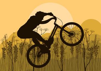 Mountain bike rider in wild nature landscape background
