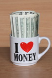 American Dollars - 100 USD Bills In Mug - Stock Pictures Photos