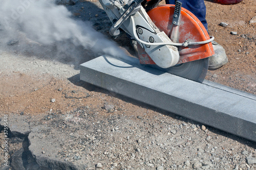 Construction cutting works with petrol driven angle grinder