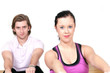 People in gym workout aerobic rowing