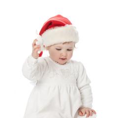 The baby girl in santa's hat