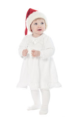 The baby girl in santa's hat with a toy