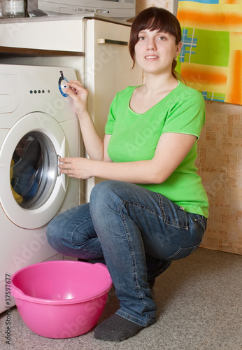 women loading the washing machine