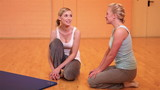 Women relaxing after workout in gym