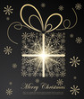 Abstract golden Christmas gift on dark background